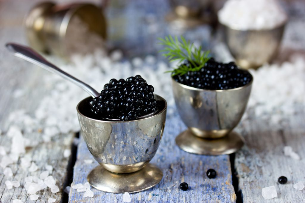 Black caviar, luxurious delicacy appetizer. Selective focus